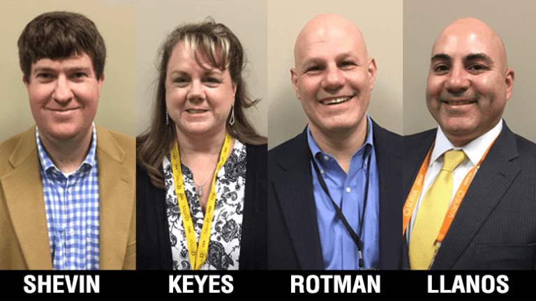 A photo of four new board members