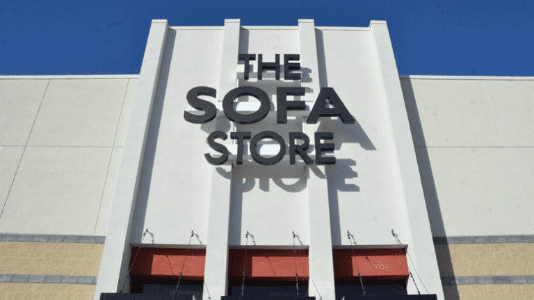 The Sofa Store logo on their building