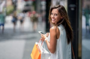 Women shopper texting on mobile