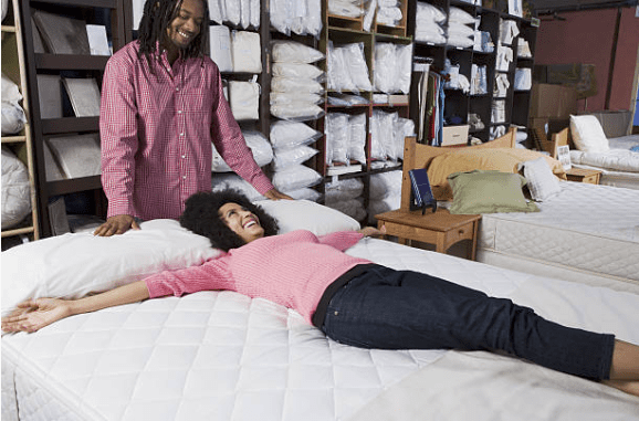 Man and woman shopping for a mattress