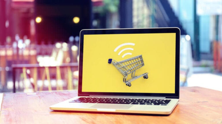 Image of a shopping cart on a laptop