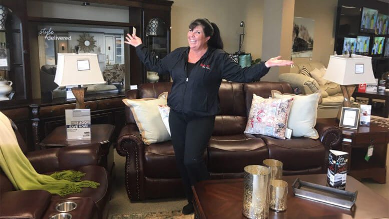 Dealer-owner Sonja Rhinehardt celebrates opening a new, temporary Badcock Home Furniture & More store in Panama City, Fla., six months after her two previous stores were flattened by Hurricane Michael