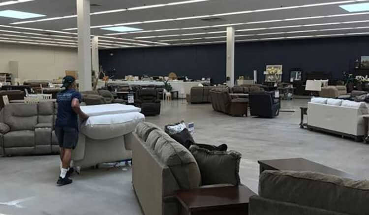 An Ivan Smith Furniture worker shuffles furniture around the company's 45th and newest store in Shreveport, La. At 50,000 square feet, the store is the company's largest.
