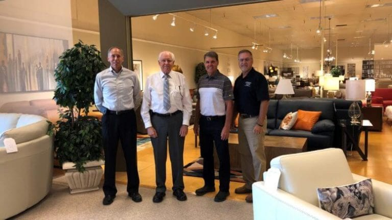 Brad Jensen, Jerry Jensen, Tom Wright and John Wright in the Jensen Home Furnishings store in Taylorville, Ill.