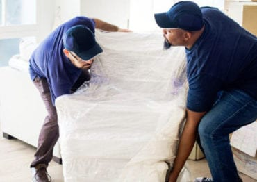 Image of Delivery people setting up furniture