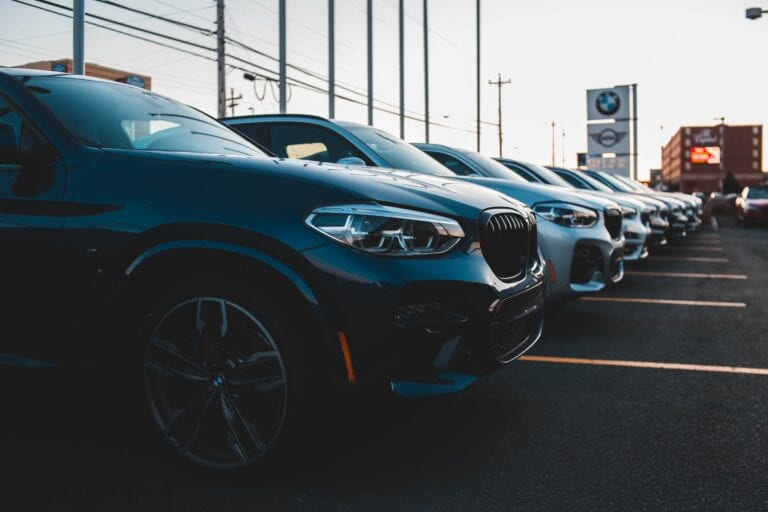 Image of cars parked at a car dealership.