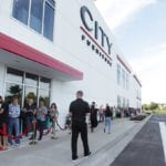 Shoppers lined up outside City Furniture's newest grand opening in Orlando to receive free $100 City gift cards.