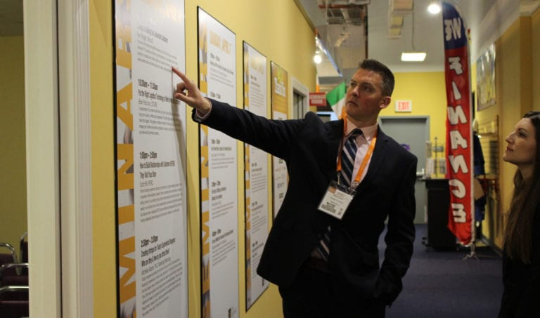 High Point Market Attendee points at seminars offered by the Home Furnishings Association