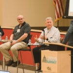 From left, Jameson Dion, Chris Fox and Greg Crowley lead a discussion on furniture safety moderated by Doug Clark