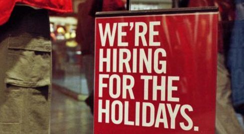 Sign advertising seasonal hiring
