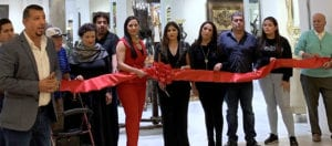 Photo shows several people cutting a ribbon
