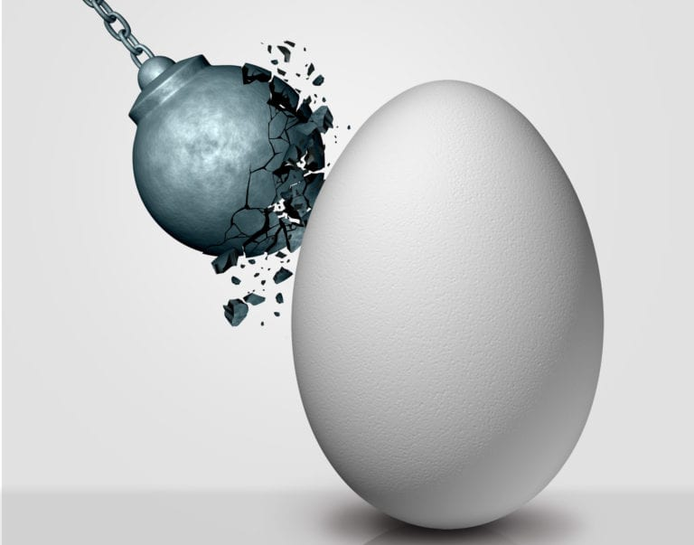 Wrecking ball striking an egg