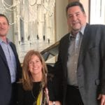 Photo shows the three owners of Howell Furniture
