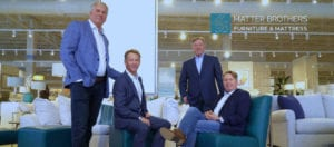 Photo shows the four Matter brothers in a furniture showroom