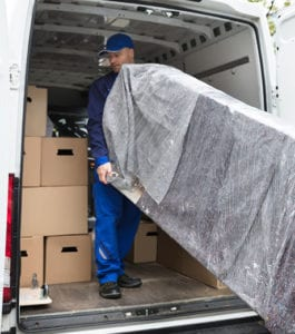 Delivery team helping to deliver furniture to a customer