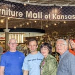 Photo shows four members of the Winter family in front of the Furniture Mall of Kansasstore