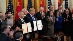 photo shows president trump and others with trade agreement