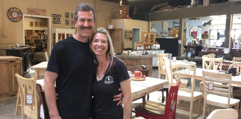 Image shows a man and woman in a furniture store