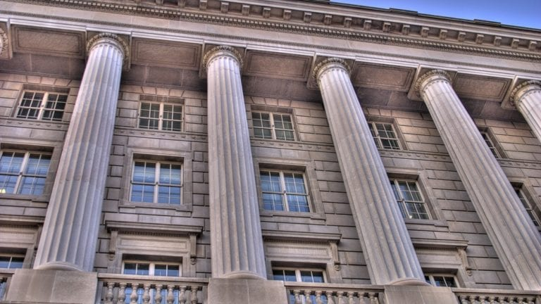 Image shows a government building with tall columns
