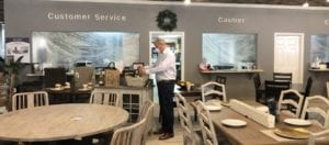 Image shows a man in a furniture store