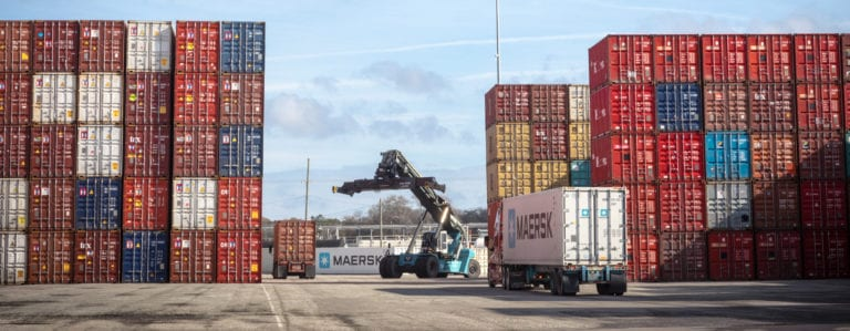 Image shows cargo containers at a port