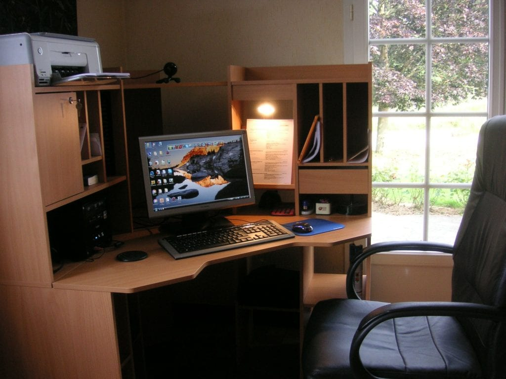 image shows a home work space with desk, chair and computer