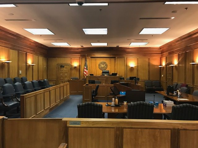 image shows a courtroom