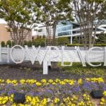 Image shows flowers, buildings and a Showplace sign