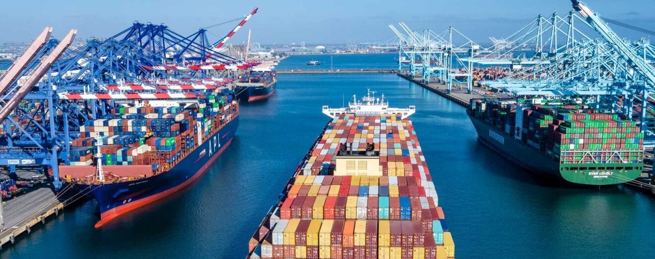 Image shows a container ship in a port