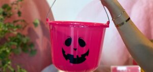 Image shows a pink Halloween bucket