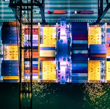 Overhead view of cargo container ship at night